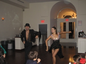 Professional competitive dancers entertain guests.